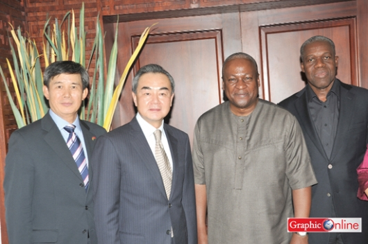 President Mahama in a pose with Mr Yi Wang (2nd left), Chinese Foreign Minister at the Flagstaff House in Accra. With them are Vice-President Kwesi Amissah-Arthur and Mr Gong Jianzhong, Chinese Ambassador to Ghana.
