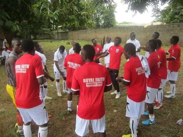Players of Dzodze Royal Faith offering prayers before the game