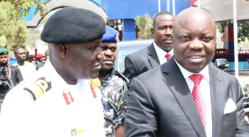 Governor Emmanuel Uduaghan of Delta State (right) and Commandant, National Defence College, Rear Admiral Patrick Agholor (left) when the governor visited the Defence College on the occasion of his lecture to COURSE 22 of the college in Abuja, Monday