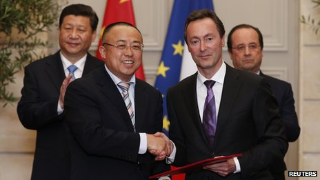 Airbus boss Fabrice Bregier shakes hands with Chinese official Li Hai in Paris