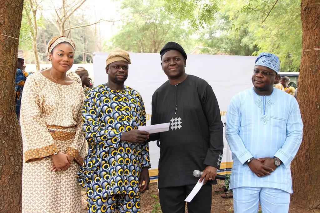 L- R ? Abimbola Okoya, Managing Director, British American Tobacco Nigeria Foundation (BATNF),  Mr.Ademola Akinlade, Ogboho2_Peepee Farmer (Beneficiary), Mr. Sola Dosunmu, Area Head of Regulatory Affairs, British American Tobacco Nigeria (BATN) and Mr. Freddy Messanvi, Corporate and Regulatory Affairs Director at the 2014 British American Tobacco Agronomy Iseyin (BATIA) farmers? productivity award ceremony held in Iseyin today, Friday 7th March, 2014.
