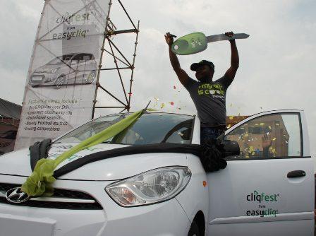 (L-R): winner of Kia Picanto brand new car, Onyekwere Melvinton (a final year student of Social Studies from Ignatius Ajuru University of Education).