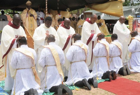 NEW PRIESTS OF OYO CATHOLIC DIOCESE BEING ORDAINED DURING THE CELEBRATION OF THE GOLDEN JUBILEE OF THE CATHOLIC DIOCESE OF OYO AT ISEYIN ON FRIDAY (12/4/13).