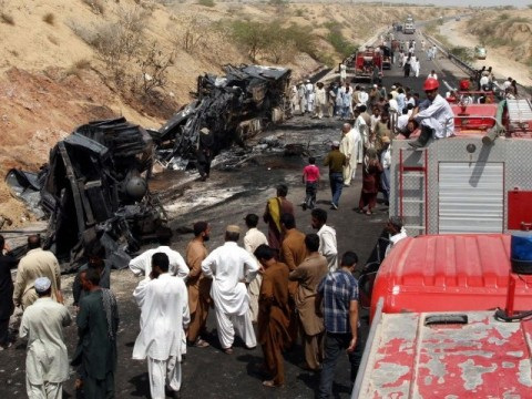 Rescue workers, officials and locals gather at the site of a suspected collision on the RCD Highway near Gadani. PHOTO: PPI