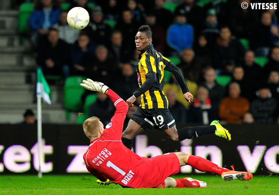 Christian Atsu chips the ball over the Groningen keeper