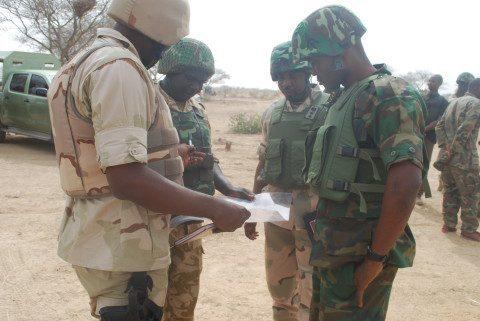 Commanders strategizing before advancing
