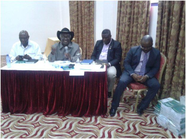 Prof. Kwamena Ahwoi, (speaking), Hon. Minister (left), and the Callistus Mahama (right)