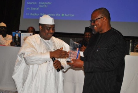 """The Speaker of the Federal House of Representatives, Hon. Aminu Tambuwal (left), presenting the Champion 2013 award of """"Outstanding Igbo Personality of the Decade"""" to the former Governor of Anambra State, Mr. Peter Obi at Intercontinental Hotel, Lagos on Saturday."""