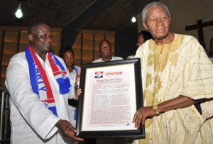 CK Tedam (R)being presented with citation for his meritorious service to the NPP at a Thanksgiving service yesterday