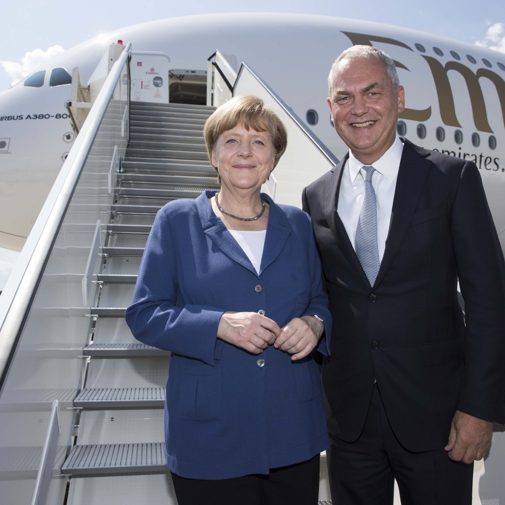 Thierry Antinori, Emirates? Executive Vice President and Chief Commercial Officer greets German Chancellor Dr Angela Merkel at the steps of the Emirates A380 display at ILA Berlin. The visit was part of the official opening tour for the airshow. Emirates now has 48 A380s in its fleet, with a further 92 on firm order.