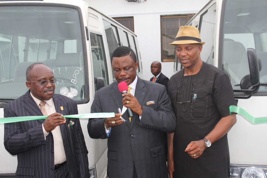 Chief Willie Obiano, Executive Governor of Anambra State (m), Head of Service, Mr. Chidi Ezeoke (L) and Dr. Nkem Okeke, Deputy Governor (R) during the presentation of Mass Transit Buses to Civil Servants in Awka...yesterday