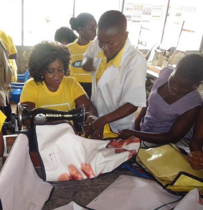 ANN YALLEY, BRANCH NETWORK SERVICES SUPERVISOR, TAKORADI SEWS SCHOOL BAG AT BIRIWA NVTI IN THE CENTRAL REGION