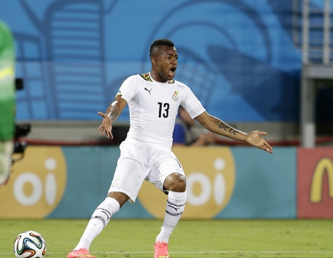 Ghana's Jordan Ayew questions the referee's call during the group G World Cup soccer match between Ghana and the United States at the Arena das Dunas in Natal, Brazil, Monday, June 16, 2014. (AP Photo/Petr David Josek)
