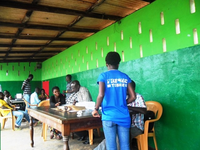 Mr Daniel Mensah (3rd from right), Registration Officer at the Neighbourhood Registration Centre attending to people