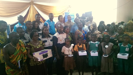 A group picture of some beneficiaries and dignitaries at the event