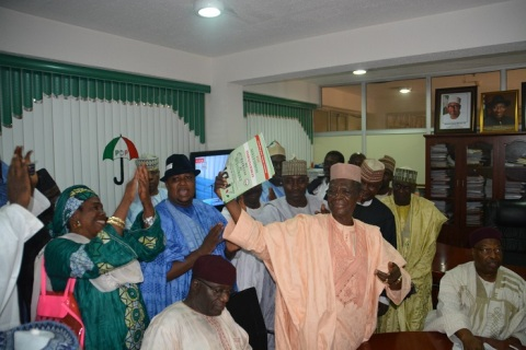 Sen Haruna Zego Aziz displaying his nomination and expression of interest forms to supports shortly after he picked the forms at the PDP National party secretary in Abuja