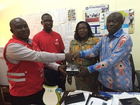 Abubakari Halidu, Zonal Business Manager for Ashanti -Airtel Ghana in a handshake with Dr Joseph Oduro, Deputy Director, Public Health.