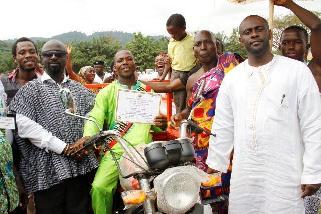 Nana Ampofo-Bekoe (in white), Mr. Isaac Tetteh - Municipal Best Farmer and Hon Ofori Agyeman Boadi - Obuasi MCE (in smock)