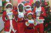 children dressed like Santa Claus