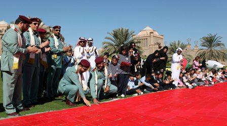 Major General Al Matroushi and Major General Al Raisi placing the last remaining pencil in the flag
