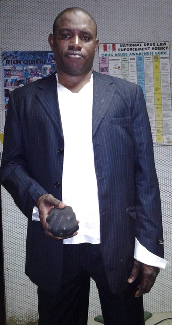 omidiya taiwo with wraps of drugs hidden inside his pants