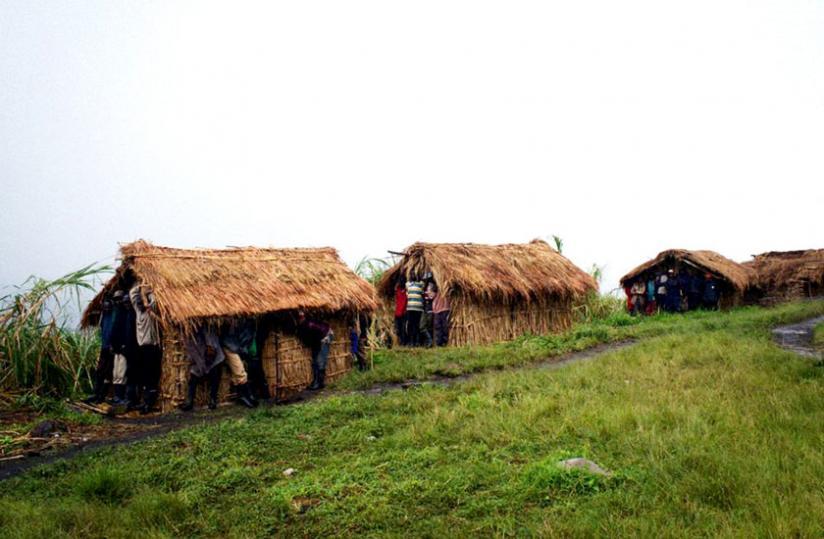 FDLR militia shelter from rain in huts outside their headquarters in Buleusa, North Kivu. (File)