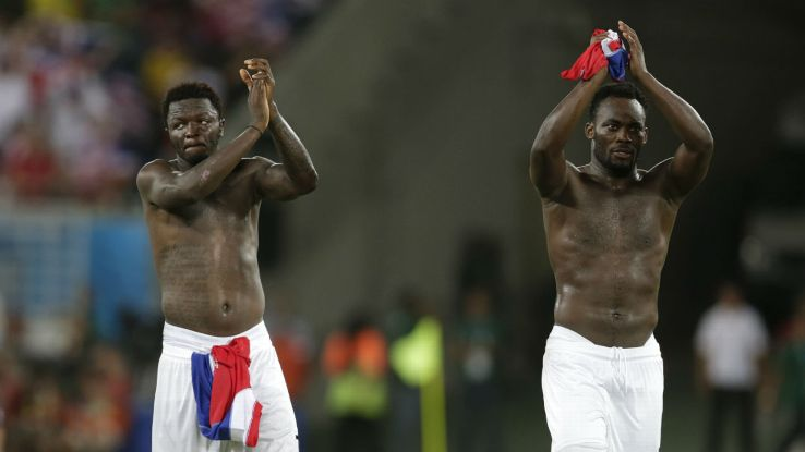 Michael Essien and Sulley Muntari after Ghana's 2014 FIFA World Cup game against the USA