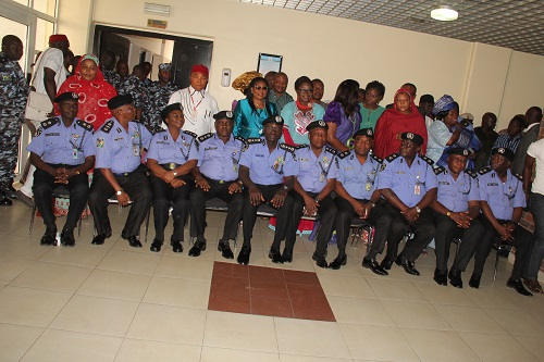 Newly promoted Officers in a group photograph with IGP & family members