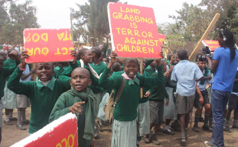 A section of Lang?ata Road Primary School pupils protest alleged grabbing of their playground by a private developer on Monday in Nairobi. PHOTO: DAVID NJAAGA/ STANDARD