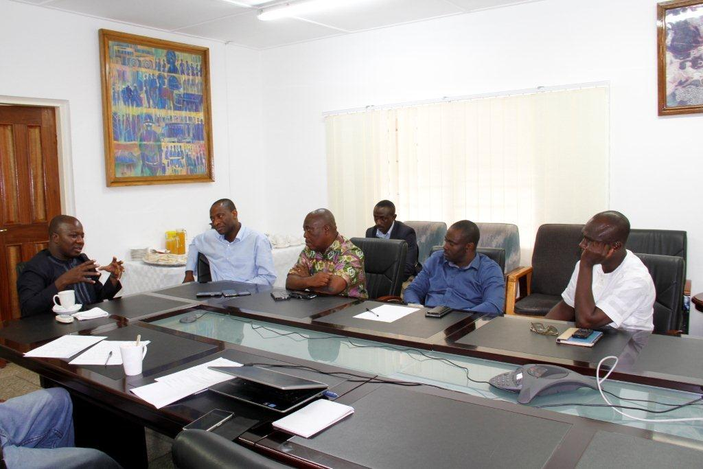 Minister explaining the initiative to MD of Obuasi mine and AshGold Exec...