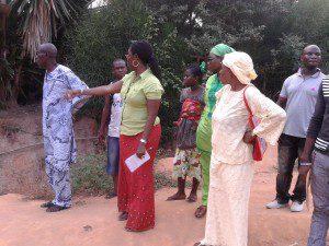 Mrs Owusu Ekuful observing environmental problems around the Akweibu School