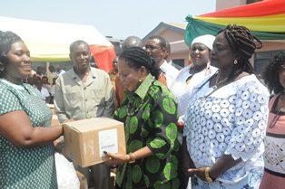 Nana Lordina Mahama presenting medical items to Dr Linda     Van Otoo, Greater Accra regional Director of Health Service.
