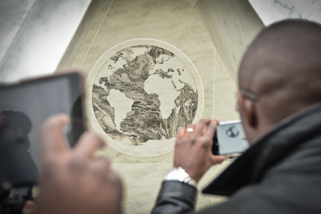 "People take pictures of a newly unveiled permanent memorial named ""Ark of Return"" at the UN headquarters in New York, on March 25, 2015. The UN unveiled a permanent memorial at the UN Headquarters in New York on Wednesday to honor the victims of slavery and the transatlantic slave trade. (Xinhua/Niu Xiaolei)"