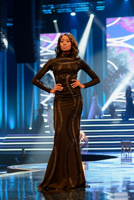 The First Princess Refilwe Mthimunye catwalks during the Miss South Africa 2015 Pageant and Celebration in Sun City, South Africa, on March 29, 2015. The Miss South Africa 2015 Pageant and Celebration was held here Sunday. Liesl Laurie from Johannesburg, 23, was crowned Miss South Africa 2015, and the runners-up are Refilwe Mthimunye from Bronkhorstspruit (1st Princess) and Ntsiki Mkhize from Kliprivier, Midvaal (2nd Princess). (Xinhua/Zhai Jianlan)