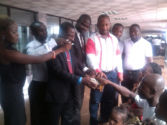 Caption  Management of Vision 1 radio station donating money to the distressed family