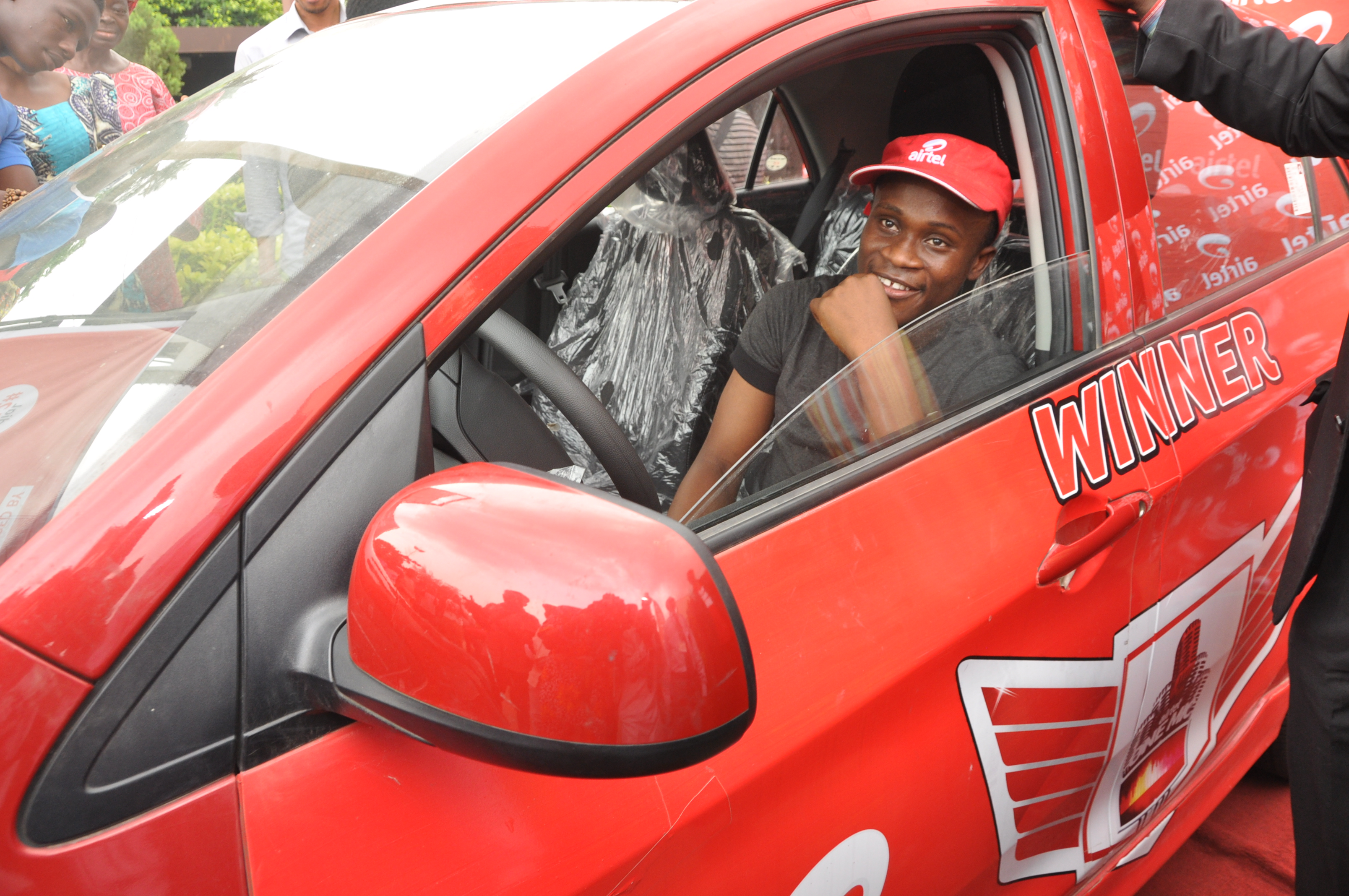 WINNER, AIRTEL ONE MIC COMPETITION: Olatunji Oladotun, aka DOTMAN, a 200 level undergraduate of University of Lagos, shortly after he received the star prize of a brand new Kia Picanto at the school premises in Akoka, Lagos