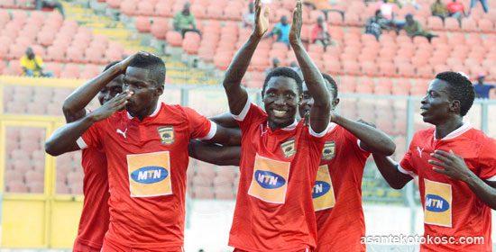 Asante Kotoko players celebrating after scoring in a league game