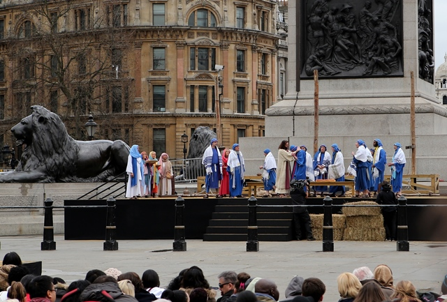 """Actors perform """"The Passion of Jesus"""" marking Good Friday in Trafalgar Square in London, Britain, on April 3, 2015. Good Friday is a Christian holiday before Easter Sunday, which commemorates the crucifixion of Jesus Christ on the cross. The Wintershall's theatrical production of """"The Passion of Jesus"""" includes a cast of 100 actors, horses, a donkey and authentic costumes of Roman soldiers in the 12th Legion of the Roman Army. (Xinhua/Han Yan)"""