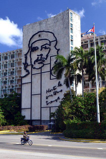 "A man rides past an image of Ernesto ""Che"" Guevara at the Revolution Square in Havana, Cuba, on April 9, 2015. (Xinhua/Joaquin Hernandez) (vf) (lmz)"