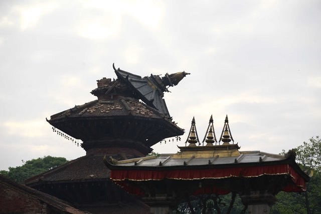 Photo taken on April 26, 2015 shows a fallen top of a temple after an earthquake at the Durbar Square in Patan, Nepal. The death toll from a powerful earthquake which struck Nepal on Saturday has climbed to 1, 896 including 723 in the Nepal's capital Kathmandu, a senior government official told Xinhua on Sunday morning. (Xinhua/Pratap Thapa)