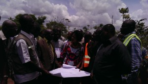 Madan Ntoso and some dignitaries studying the Ho Airport site plan.