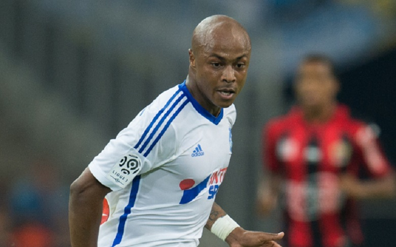 Andre Ayew being chased by a host of clubs