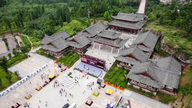 The aerial photo taken on June 12, 2015 shows the Dazu rock carvings expo park in Dazu County, southwest China's Chongqing Municipality. The Dazu rock carvings expo park, renamed from Baoding Rock Carving Scenic Spot, was officially opened to the public on the 13th China cultural heritage day Saturday. Started in the middle of the 7th century, the Dazu Rock Carvings are made up of 75 protected sites containing some 50,000 statues, and were listed as a World Heritage Site in 1999.   (Xinhua) (yxb)