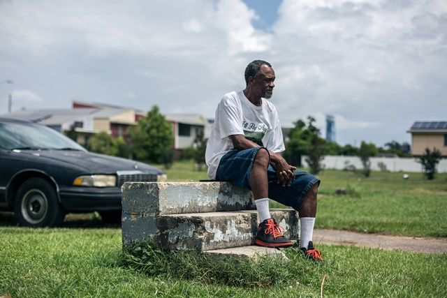 Robert Green, a Lower Ninth Ward resident and Hurricane Katrina survivor, sits on the steps that once led into his mother's Lower Ninth Ward home in New Orleans, in Lower Ninth Ward, New Orleans, June 12, 2015. Green lost his mother and granddaughter in 2005's devastating hurricane Katrina. Ten years after Hurricane Katrina brought New Orleans to its knees and left an emotional footprint across the United States as people witnessed how the U.S. government failed to respond promptly, a predominantly African-American community of the city still struggles to define what their post-Katrina life would be. (Xinhua/Li Muzi) (lrz)