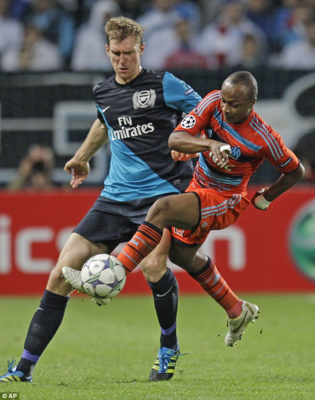 Ayew nips in to steal the ball in front of Arsenal defender Per Mertesacker in a 2011 Champions League game