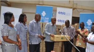 Ag. MD, HFC Bank, Mr. Le Hunte flanked by other officials of the bank, presenting items to Dr. Obeng Apori, Medical Officer in charge of the Ridge Hospital
