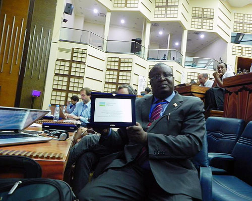 Uganda Land Alliance (ULA) executive director Edmond Owor displays the award in Dakar. (Courtesy photo)