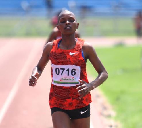 Emily Chebet on her way to winning the girls 3000m race during Athletics Kenya World Youth Championships national trials at Nyayo Stadium, Nairobi yesterday. PHOTO:DENNIS OKEYO/STANDARD