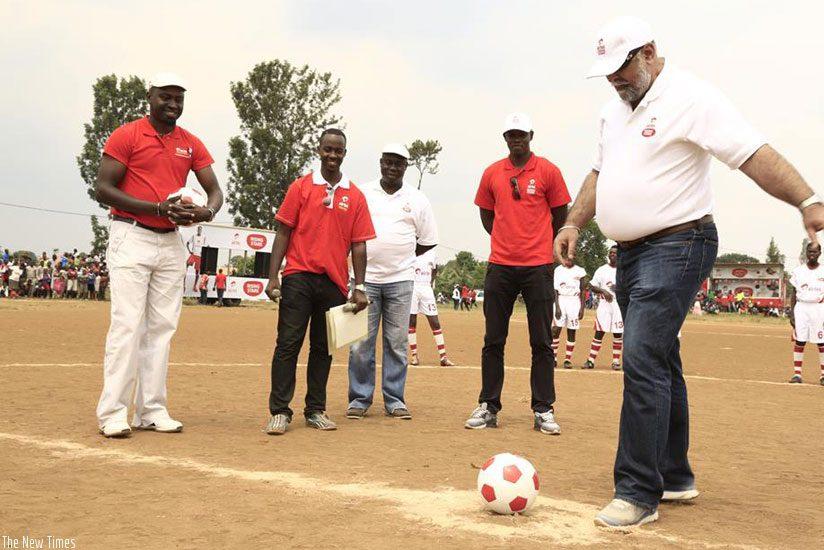 Mr. Bhullar kicking the ball to officially kick off Season 3 of Airtel Rising Stars in Rwamagana yesterday. (Courtesy)