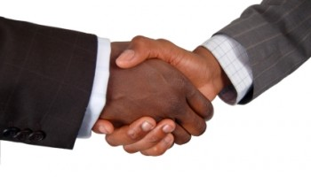 Handshake Galore; Ghanaians Show Defiance To Ebola Scare
